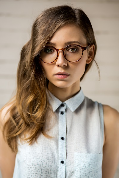 Beautiful hipster Ukrainian girl wearing stylish glasses with her hair down